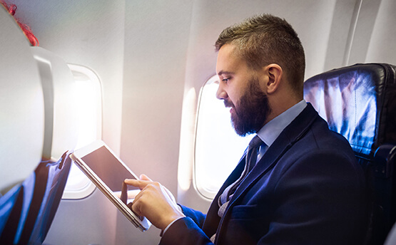 The traveling businessman and his tablet.